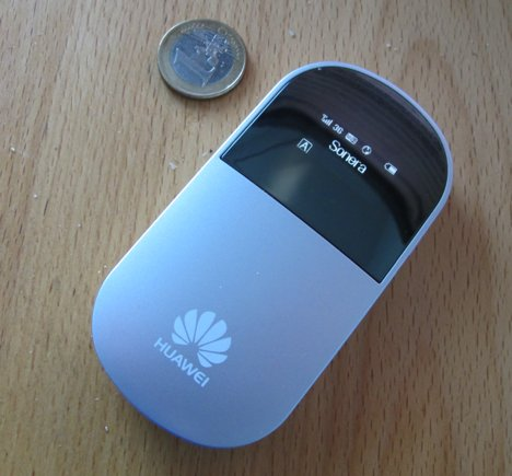 Huawei E5 is small enough to fit most pockets (here pictured next to the 1 EUR coin), and weighs only about 90 grams. The LCD display could be better, but the device is easy to setup with its browser based user interface.
